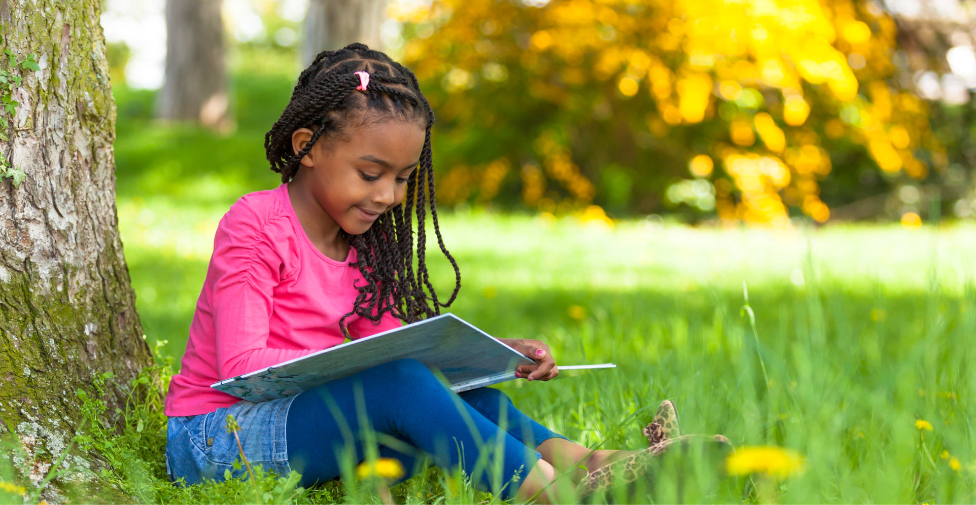 Girl_reading_under_a_tree